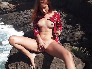 Agatha masturbating on a rocky shore and loving every morsel